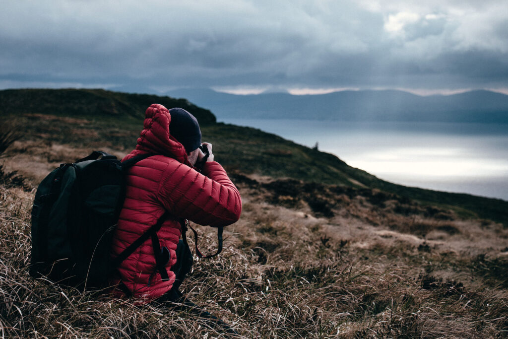 A man photographs a cloudy landscape